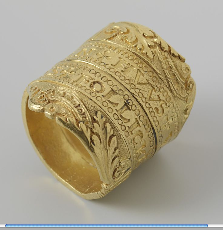 Gold wedding ring in the form of a spiraling belt. Inscribed. Netherlands, circa 1550
