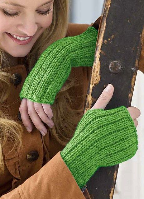 Free knitting pattern for easy Lovely Glovelets fingerless mitts - Cathy Payson's ribbed mitts for Red Heart are knit flat and seamed.