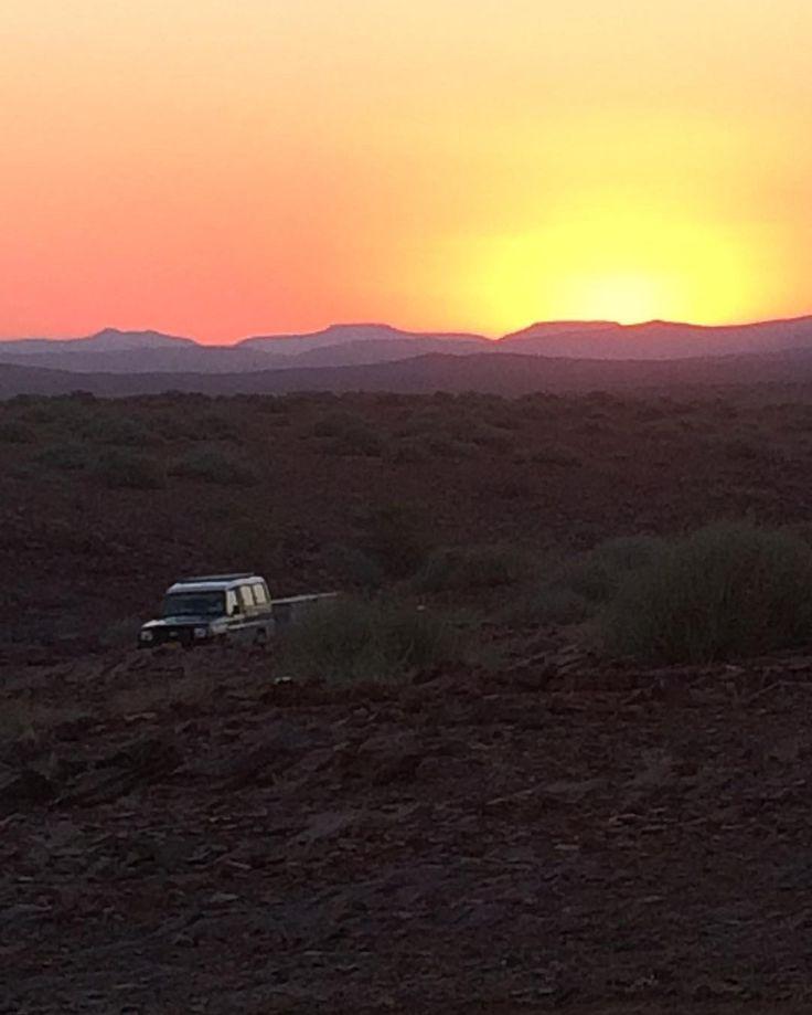 Watching the sun set in Damaraland, Namibia.