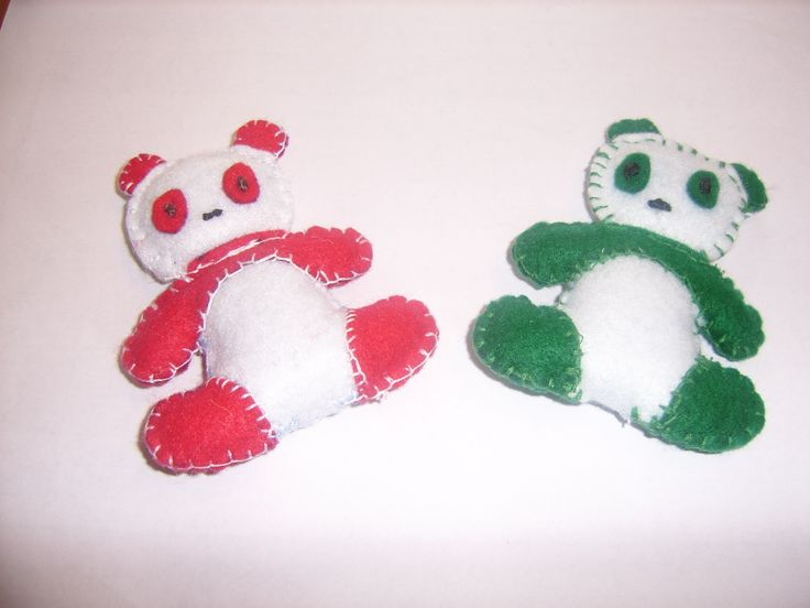 This toy is made by me from felt, hand sewn and embroidered with cotton thread, filled with recycled wood.