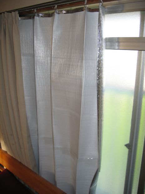 DIY Heat blocking curtains - could ad nicer fabric to back to have all in one panels for upper windows - sans the creases, too!