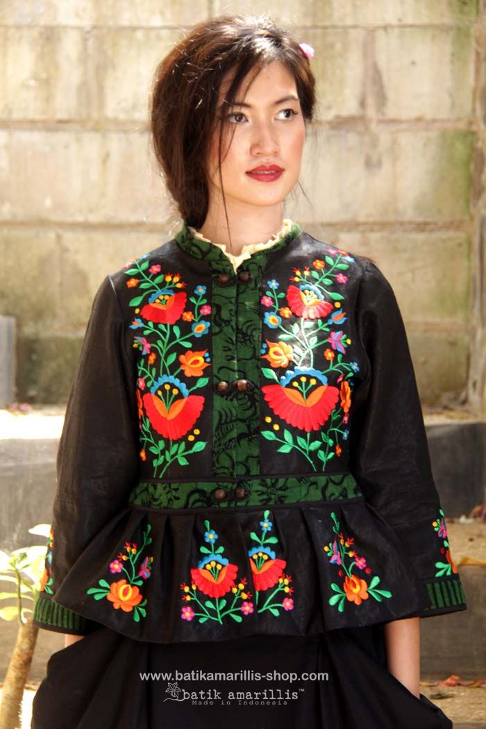 batik amarillis's primavera jacket strikes the perfect balance between classic & contemporary with this beautiful black velvet jacket with multi colored Hungarian folk embroidery meets tenun batik gedog Tuban,Indonesia.this sartorial essential is reworked with unique beaded buttons & peplum-inspired pleating. Wear yours with everything from skirt, tailored trousers to jeans.