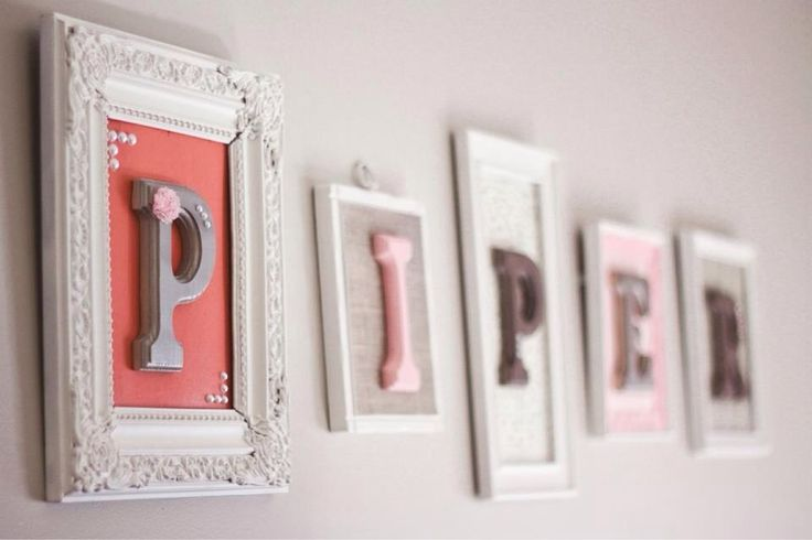 Letters for Piper's Nursery - purchased frames at a thrift store, spray painted them, and used scrapbook paper and wooden letters to personalize them with her name!