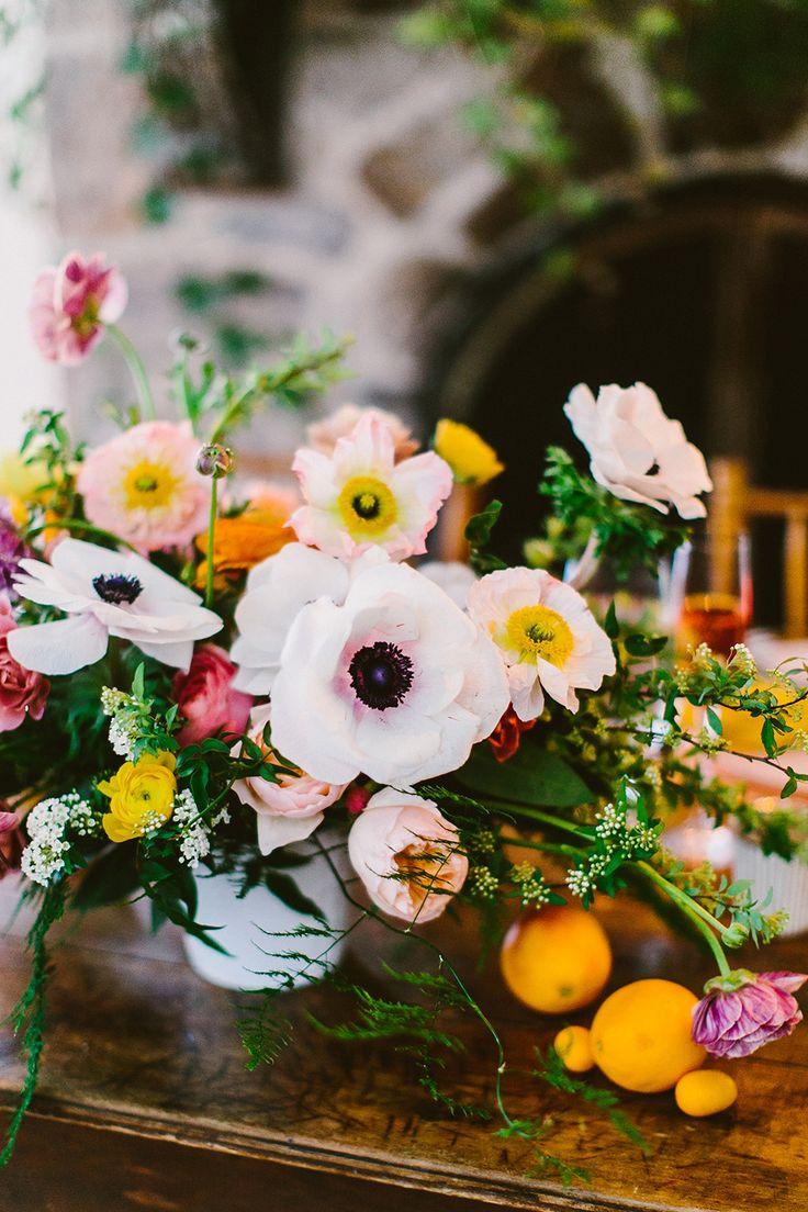 anemone wedding centerpieces - photo by Redfield Photography http://ruffledblog.com/one-table-three-ways