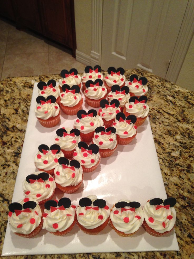 Strawberry Minnie Mouse cupcakes forming a number 2. https://www.facebook.com/sweetnsassycakesbyeva