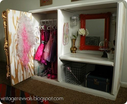 """Vintage Revivals: Little Girl Dress up Vanity made from an old ugly TV Stand.  Beautiful """"full size"""" gold mirror on the front of the """"closet door"""".  Check out the rest of the pictures of this project when the vanity lights are on!"""