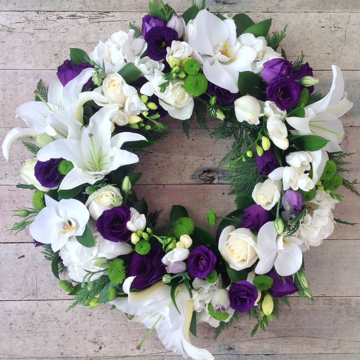 Sympathy wreath in classic whites and deep purple.