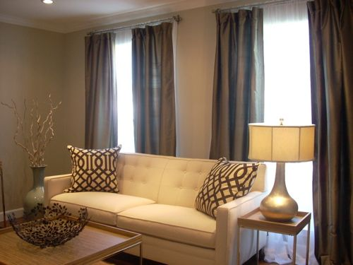Brown, taupe, cream living room...low the colors and accent pillows
