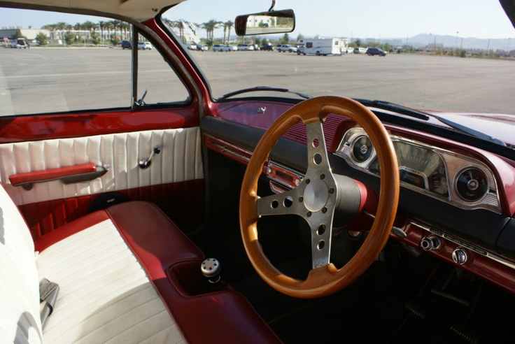 An EH with a wooden steering wheel - going, going, sold for $19k... what? Only in the US.