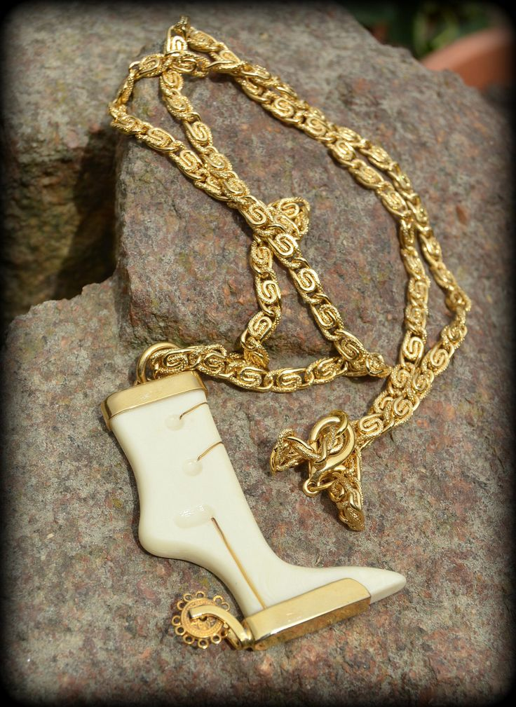 1970s cowboy boot pendant necklace ~ galalith pendant and gold metal chain necklace by CatsAndHatsVintage on Etsy