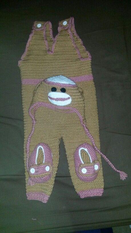 Baby jumpsuit, booties, and sock monkey crochet set.