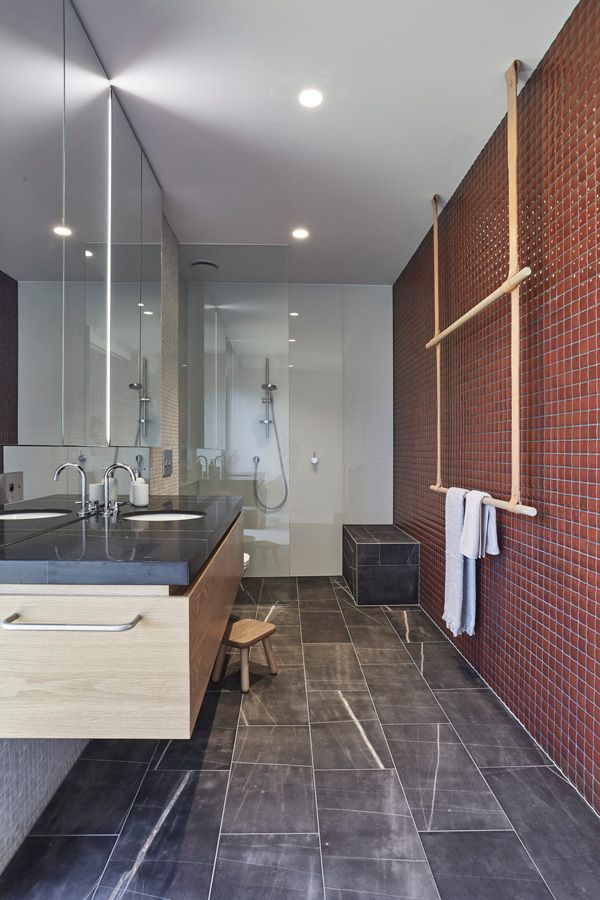 This open bathroom is luxurious yet safe with its one level design, bench seat and wall wounded contemporary vanity
