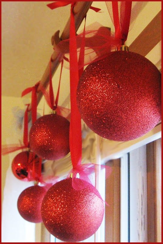 Styrofoam balls, sprayed with glue and then rolled in glitter. Much cheaper than huge ornaments and less breakable too