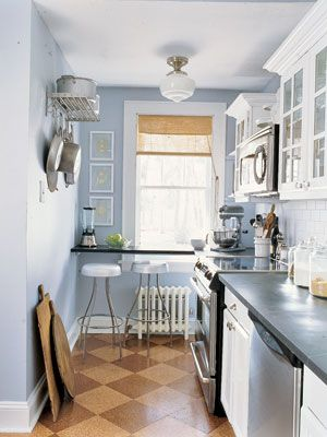 Small space idea: Extend the countertop across a window to create an eating area and prep zone.    Read more: Kitchen Designs - Pictures of Kitchen Designs and Decorating Ideas - Country Living