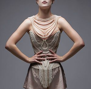 Harking back to the golden age of burlesque, this custom corset is covered in thousands of hand sewn pearls. Bespoke corsetry and burlesque costumes in Berlin