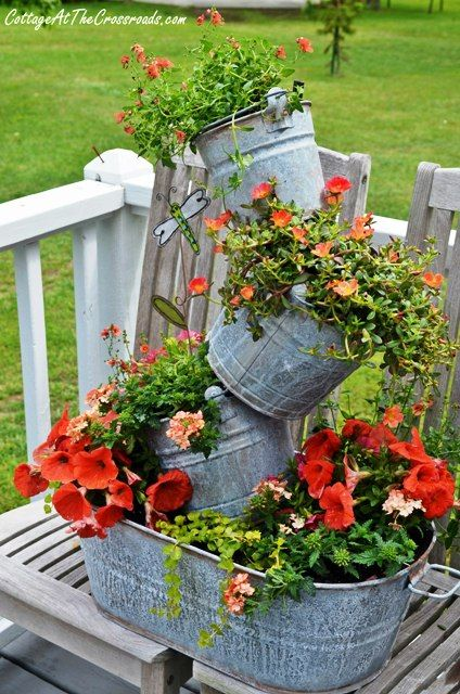 Fun topsy turvy planter made from repurposed farm equipment. Tons of great ideas…