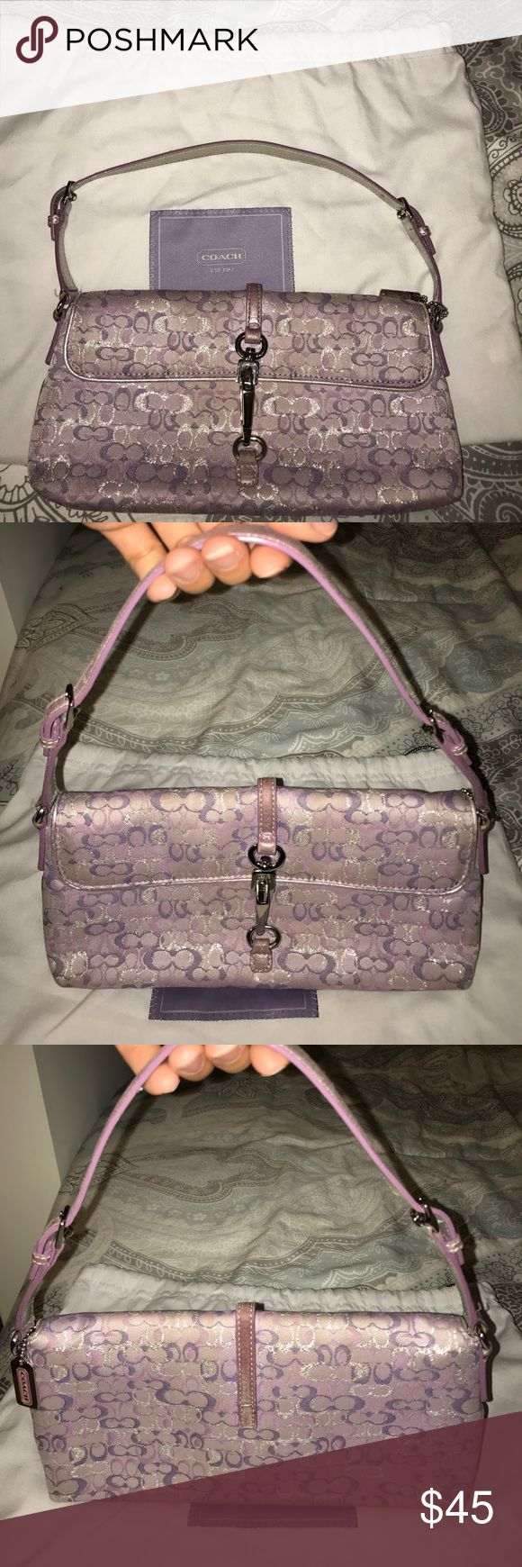 """Coach Clutch Purple canvas coach clutch with purple and silver leather details. Gently used. Strap that holds the clasp is slightly worn. Recently cleaned. 12"""" wide x 5"""" high. 11"""" high with strap fully extended. Coach Bags Clutches & Wristlets"""