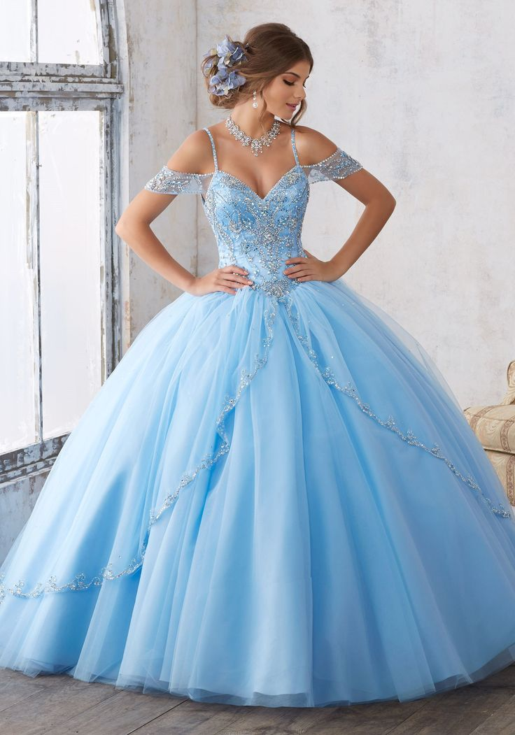 Dramatic and elegant, radiate the room in a Mori Lee Vizcaya Quinceanera Dress Style Number 89135 at your Sweet 15 party. Made out of tulle, this Quince dress features off-the-shoulder cap sleeves top