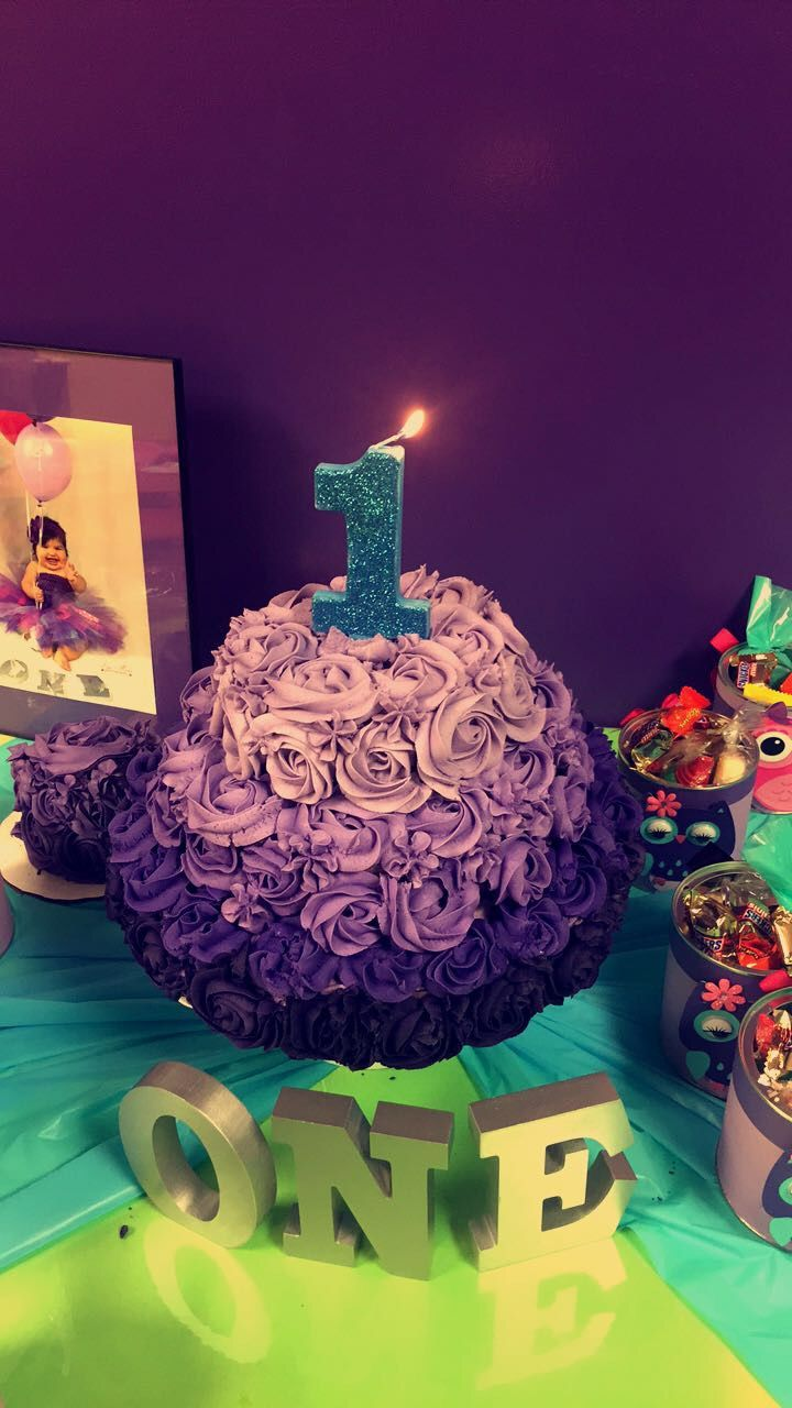 Baby girl birthday purple smash cake homemade dyi rosettes ombre first birthday and gift buckets