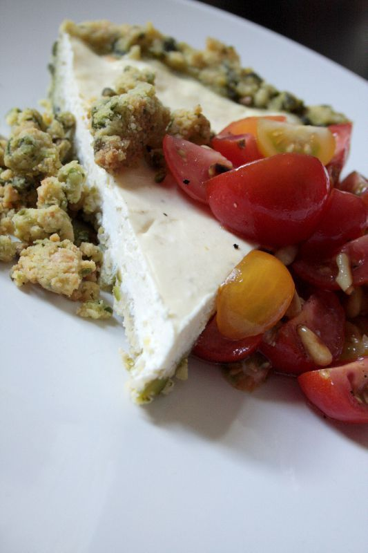 Cheesecake with goat cheese and cherry tomatoes, salty pistachio crumble