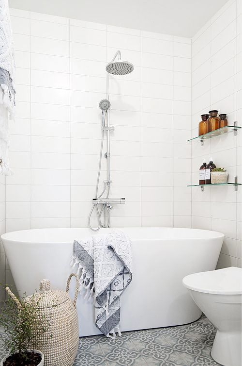 I like the cement tile with white wall tiles in a grid pattern. Ignore the tub.