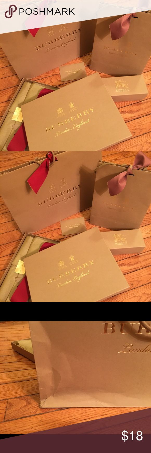 Lot of Burberry shopping bags 2 Burberry shopping bag 1 scarf box with tissues ribbon small envelope 1 Burberry sunglasses box Ribbons Creases bottom of the bag as shown Burberry Bags