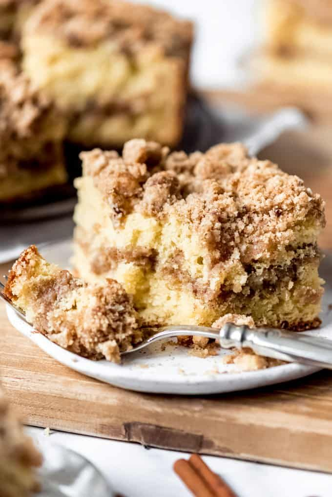 This Scrumptious Sour Cream Coffee Cake Has A Ribbon Of Cinnamon Streusel In The Middle And Even More Of In 2020 Sour Cream Coffee Cake Coffee Cake Recipes Coffee Cake