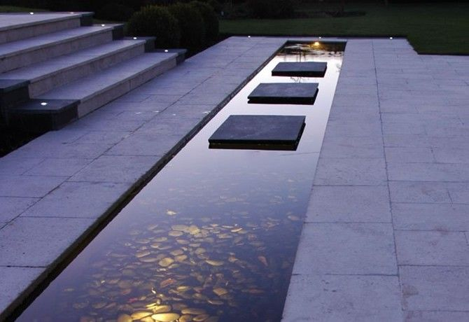 Too modern for my farmhouse, but really beautiful. Contemporary minimalist water feature with atmospheric underwater lighting