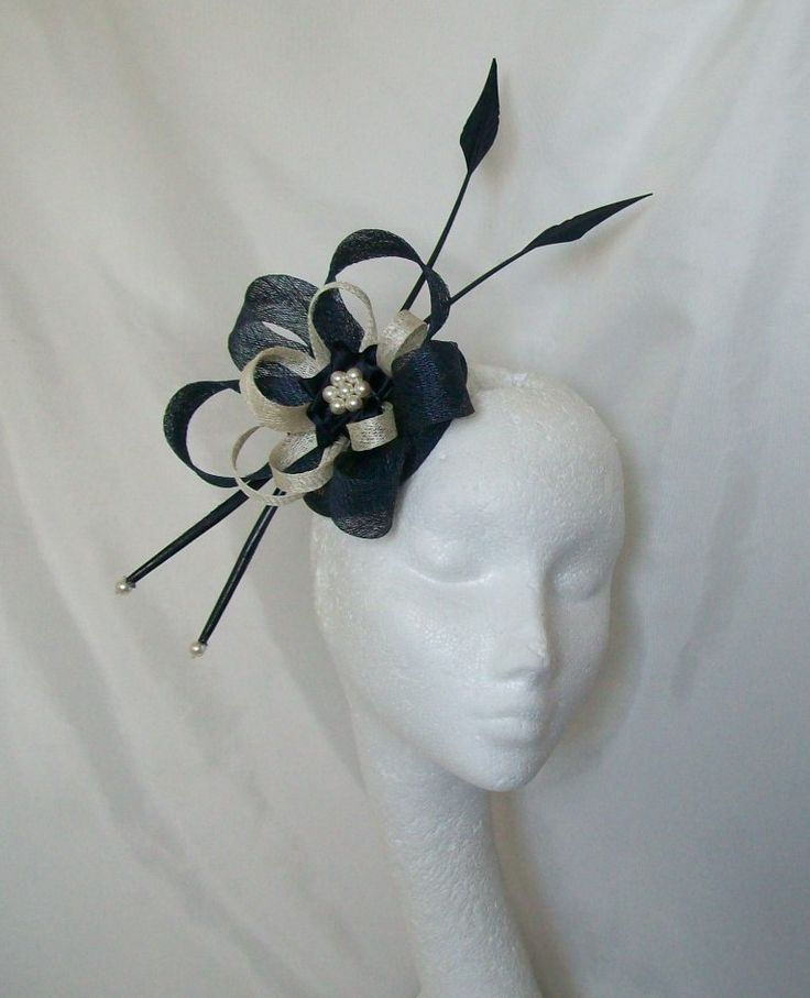 Navy & Ivory Florence Fascinator Mini Hat by www.indigodaisyweddings.co.uk Specialising in stunning bespoke cocktail fascinators and formal hats in a wide range of colours, perfect for Royal Ascot and The Kentucky Derby. Plus all your wedding floral accessories including shoe clips, vintage flapper bands, feather and flower fascinators, feather fans, fairy wands, wrist corsages, wedding bouquets & buttonholes. Worldwide Delivery.