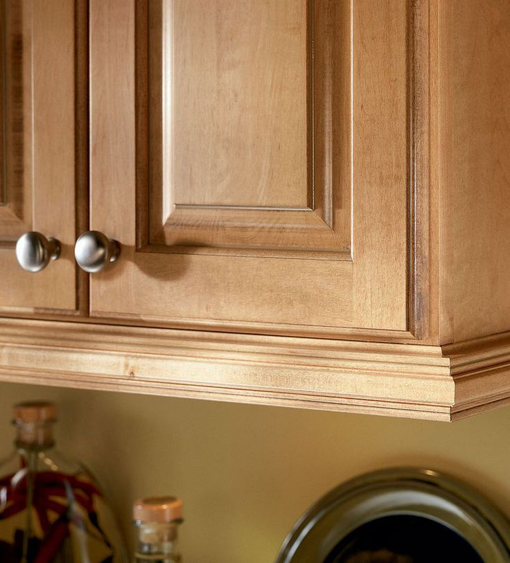 how to put trim on kitchen cabinets
