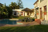 WOODBRIDGE LODGE, Milnerton, Cape Town - Large and elegant Guest House in centrally located Milnerton with stunning views of Table Mountain. All rooms en-suite, beach, shops and restaurants within walking distance. Honeymoon suite. Conference facilities offered.