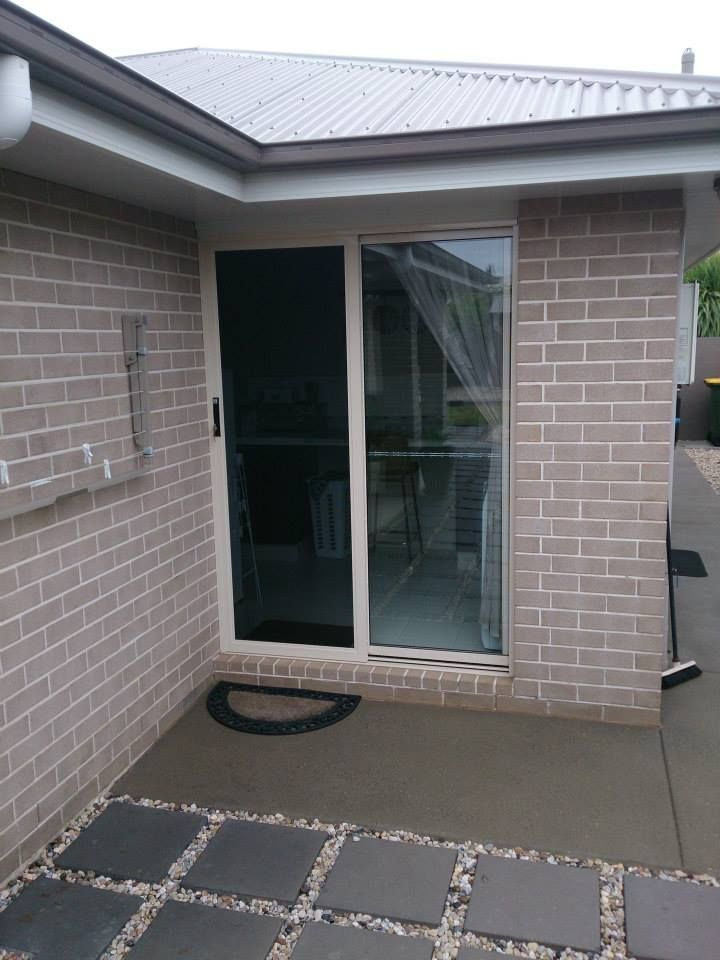 ForceField sliding security door in the powder coat 'Barley' installed by Safehome Security Screens on this lovely home in Toowoomba.