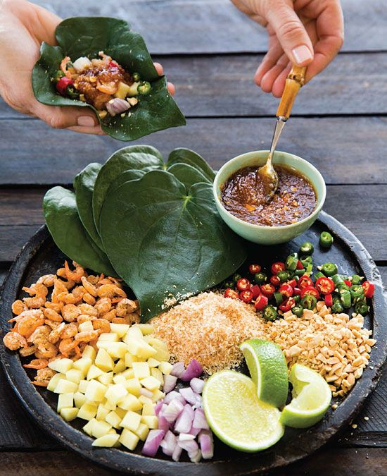 Leaf-Wrapped Salad Bites (Miang Kham) - - - - Mini Mango Thai Restaurant in Napa makes these in small Butter leaf lettuce cups. They call them 8 Element wraps!! Delicious