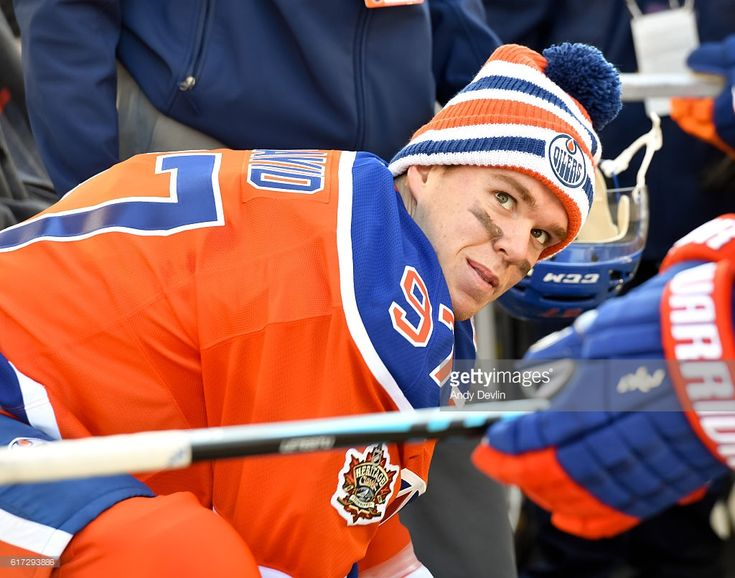 Connor McDavid #97 of the Edmonton Oilers sits on the bench during warmup in advance of the 2016 Tim Hortons NHL Heritage Classic game at Investors Group Field on October 22, 2016 in Winnipeg, Canada.