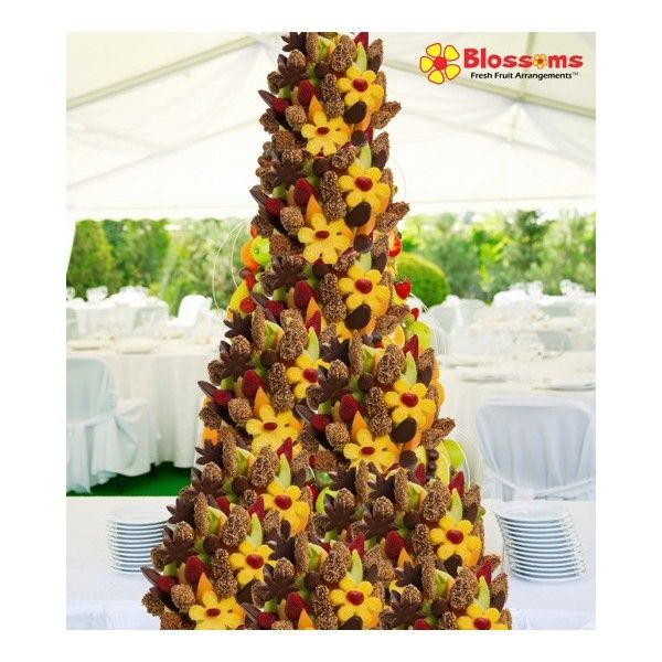 Chocolate Blossoms Fruit Bouquet Tower  Are you looking for that spectacular centerpiece that is sure to wow all of your guests? This tower was designed specifically for you! Perfect for any wedding, corporate event, party and gathering. Stand out and let your party be the talk all year!