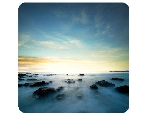Muurprint zonsondergang over de oceaan