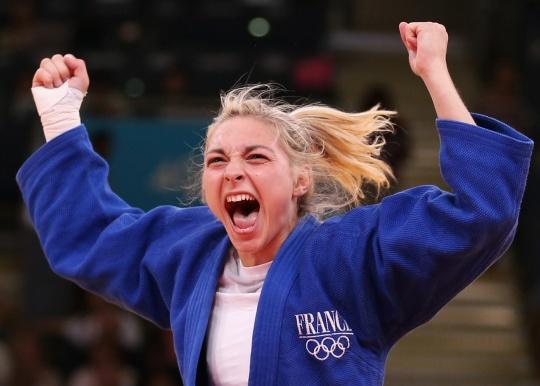 Automne Pavia of France celebrates her bronze medal victory - women's 57kg judo match.