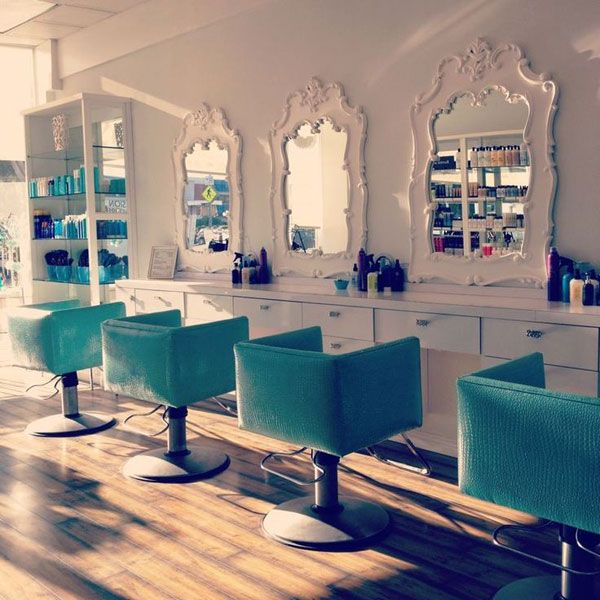 Cool Turquoise Chairs, White Mirrors For This Salon Decor!