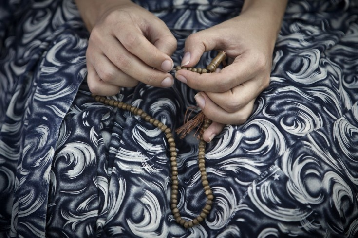 Aug. 19, 2012. An Iranian woman with her prayer beads during an Eid al-Fitr prayer in the Olympic Village neighborhood in western Tehran.