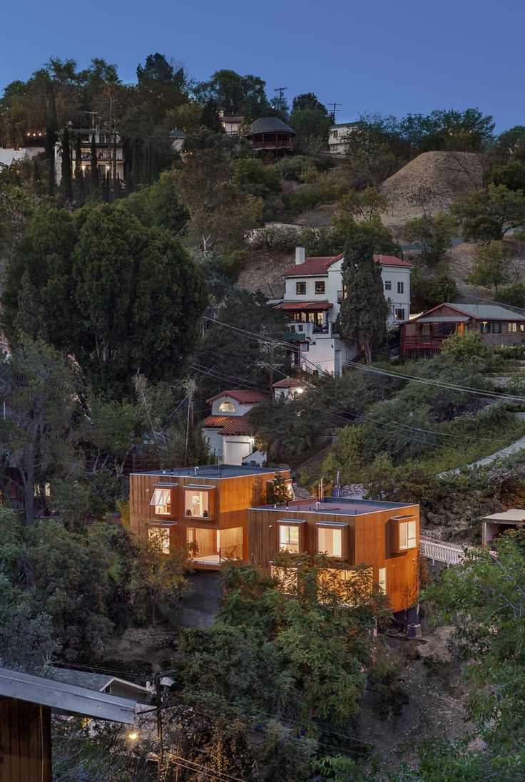 Los Angeles-based firm Anonymous Architects cantilevered side-by-side houses over two steep lots in Los Angeles's Mount Washington neighborhood