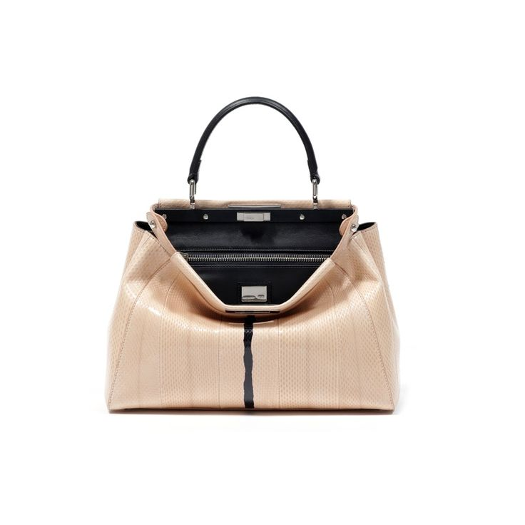 Play Peekaboo With This Luxe Pocketbook