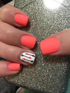 Orange with signature nail in white, black, and orange arrows