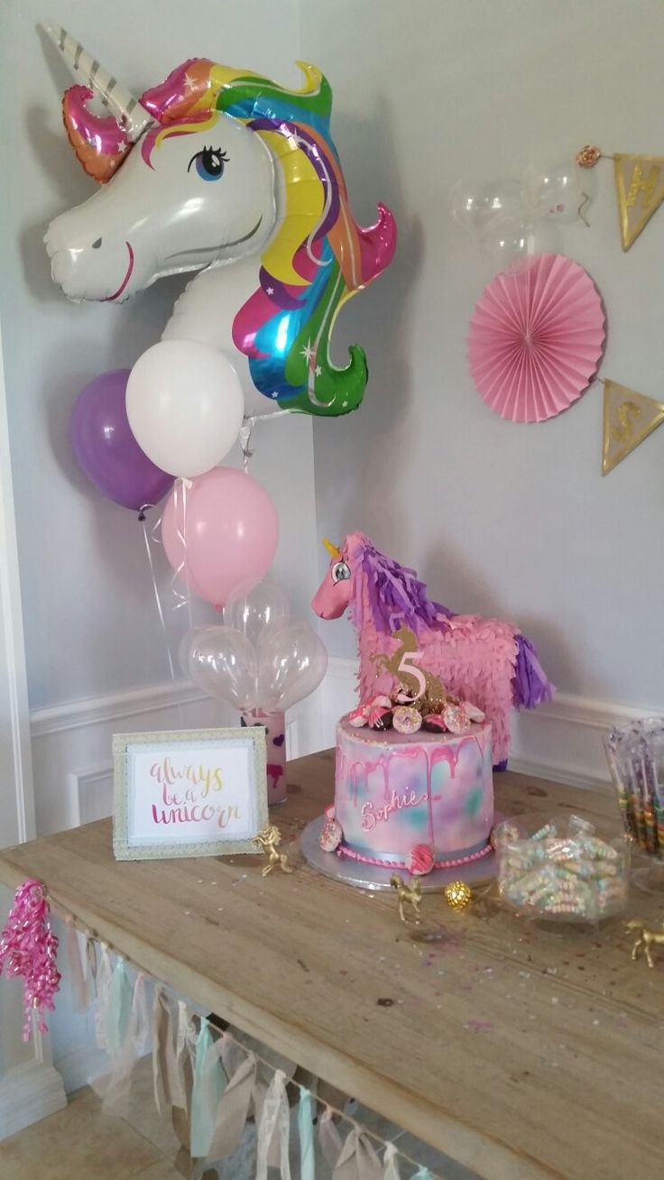 Beautiful birthday cake, unicorn balloon, unicorn piñata