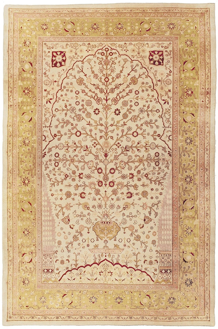 """AGRA TREE OF LIFE - Northern India, 9ft 0in x 13ft 5in, Late 19th Century. A delicately rendered depiction of the """"Tree of Life"""" or """"World Tree,"""" a inspiring symbol in virtually every culture is the focal point of this exquisite, wonderfully understated antique Agra Oriental carpet."""