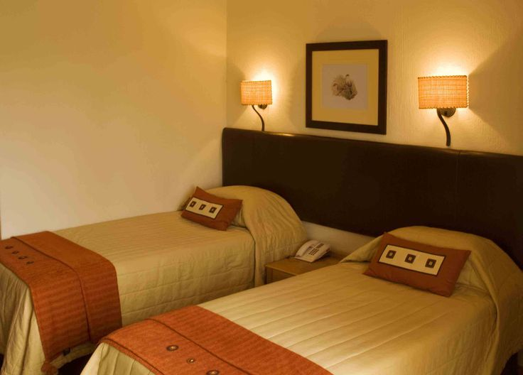 Offering space and comfort the standard hotel room at Glenburn Lodge has Double/Twin beds (king-size bed or 2 twin beds). The small patio overlooks the lodge's stunning surroundings.  #atGuvon