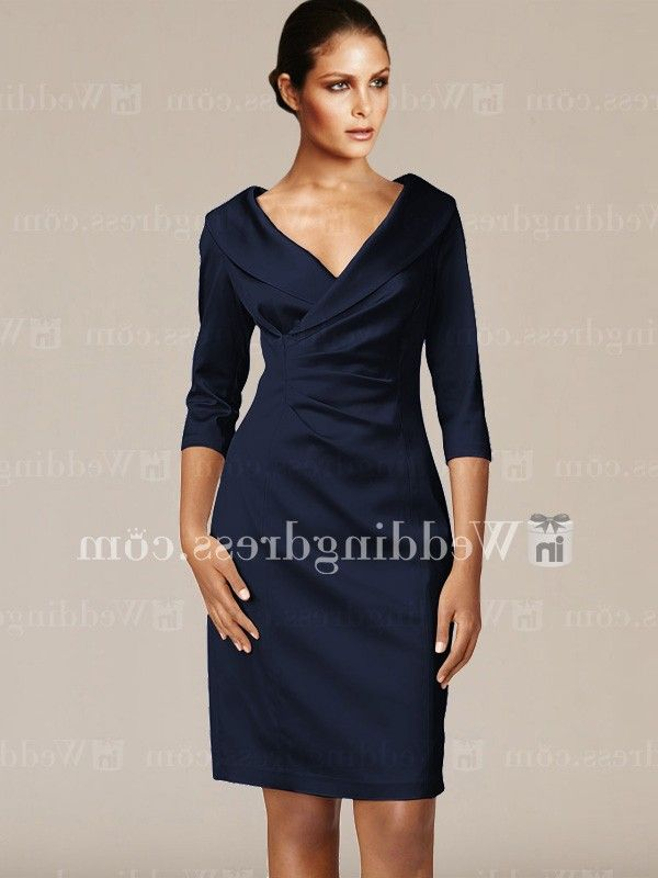 Mother of the bride short dress features a flattering portrait collar and a wide, low neckline style a dress shaped with princess seams and pleated to give a subtle wrap-like illusion.  Available in 60 colors, shown in Navy.