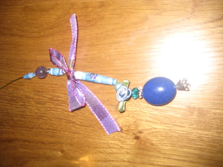 Paper beads strung with ribbon and beads - cord pull , pictured on its side