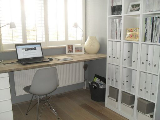 Office- Simple desk in front of window. Storage side wall