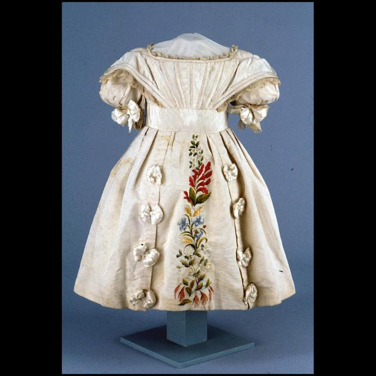 "Girl's dress, silk embroidery 1825-1835 Origin: America or Europe OL: 29"" Ribbed silk; linen bobbin lace; silk embroidery. Gift of Tasha Tudor.DS1997-0175"