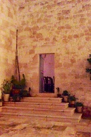 The steps leading to the chapel door - mauve light beckoning.